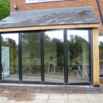 hand crafted oak extension - with Glass folding doors
