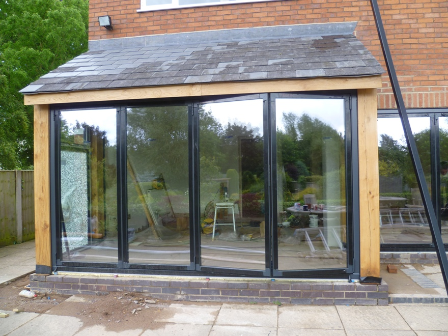 Hand Crafted Oak Extension With Glass Folding Doors
